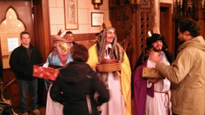The Three Kings handing out goodies and conversing after the Mass of the Epiphany