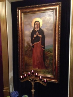 A picture of Our Lady of Sorrows (Mater Dolorosa) in the re-creation of the Garden of Gethsemane at Most Sacred Heart of Jesus Roman Catholic Church in Wallington