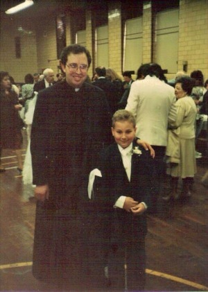 Father Michael Marotta, CRM, and I at my 1st Holy Communion