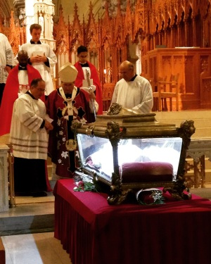 His Grace Archbishop John Myers recessing past the reliquary containing the Major Relics of Saint Maria Goretti after Holy Mass