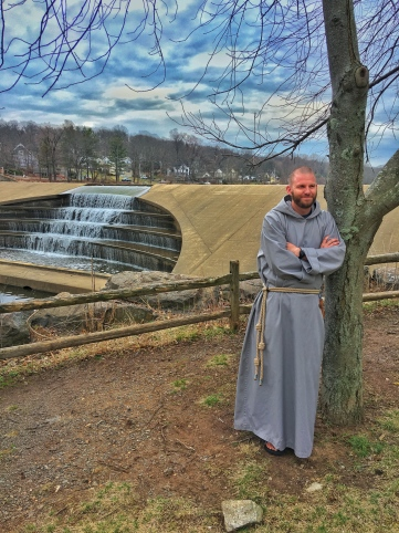 Brother Simon with the Watchung Circle Waterfall behind him after filming a short Lenten video for 206 Tours in Watchung, NJ.
